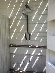 An outdoor shower to wash away the day's sand
