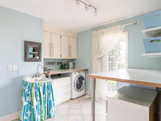 Large laundry room with full iron board and iron for guests