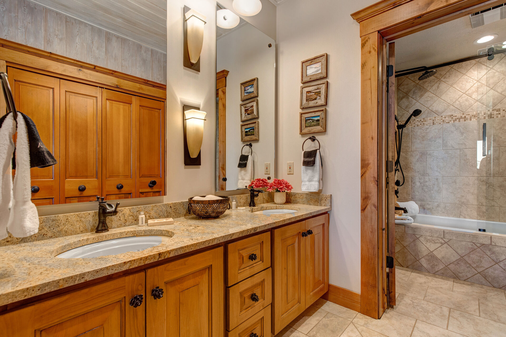Master Bath 4 with Dual Stone Counter Sinks and a Separate Tub/Shower Combo with Multiple Shower Heads