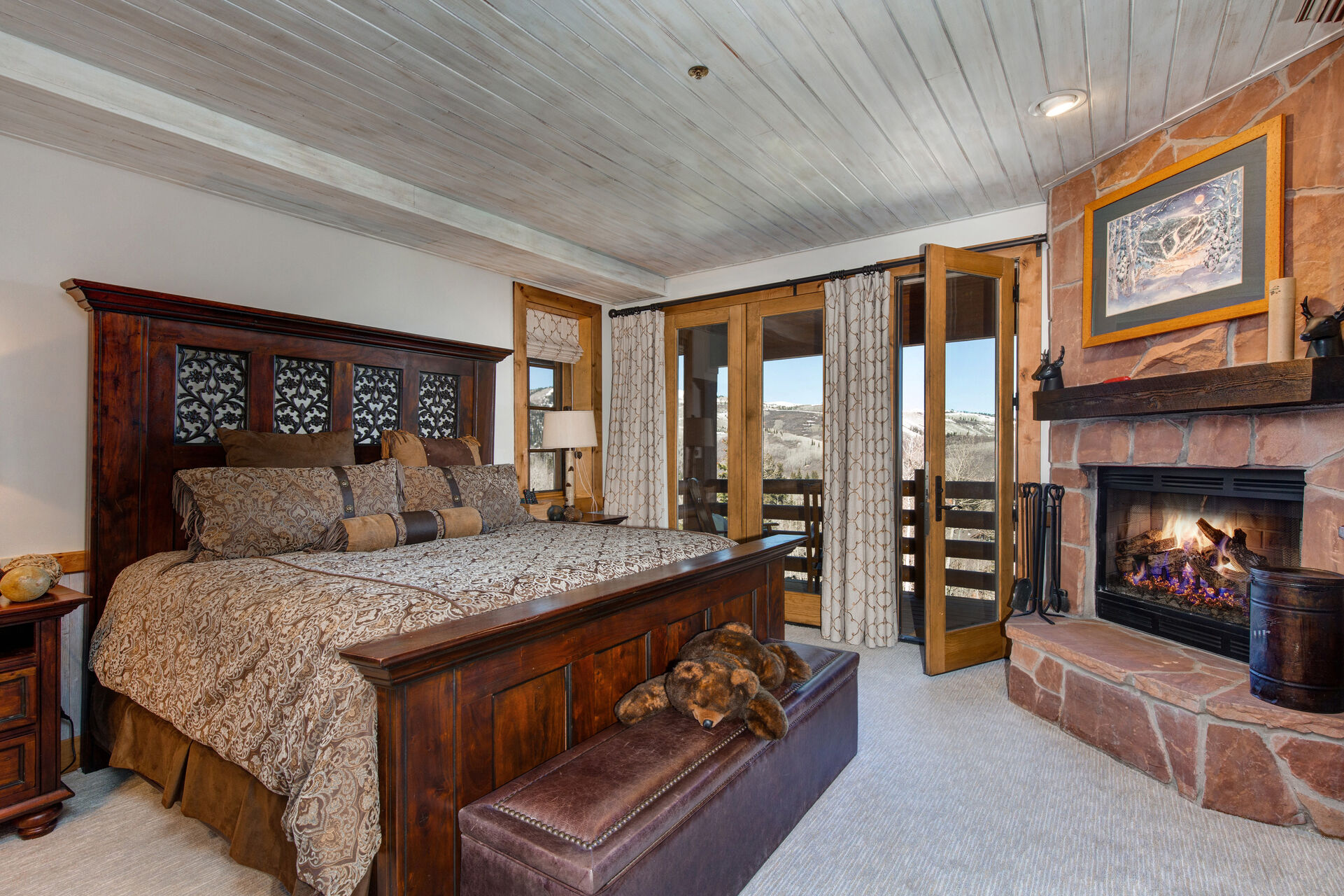 Lower Level Master Bedroom 4 with a King Bed, a Fireplace With Clean Burning Fire Logs (Provided), a 45
