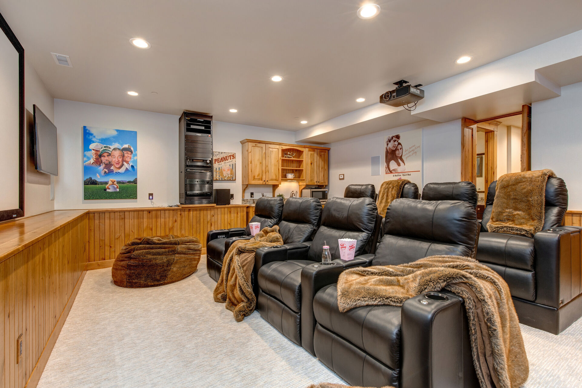 Theater Room with a Big Screen and Two 50