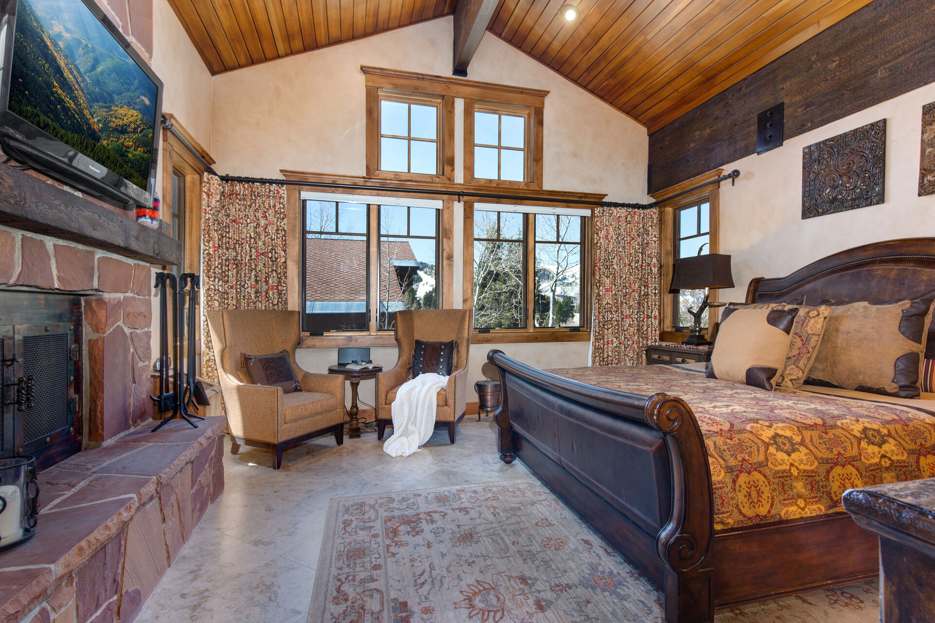 Grand Master Bedroom with a King Bed and a Fireplace With Clean Burning Fire Logs (Provided)