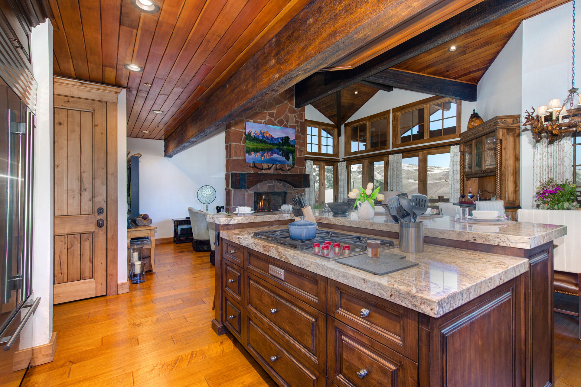 High-end Appliances Including a Wolf 5-Burner Gas Stovetop, Double Wolf Convection Ovens, SubZero Refrigerator and Wine Fridge