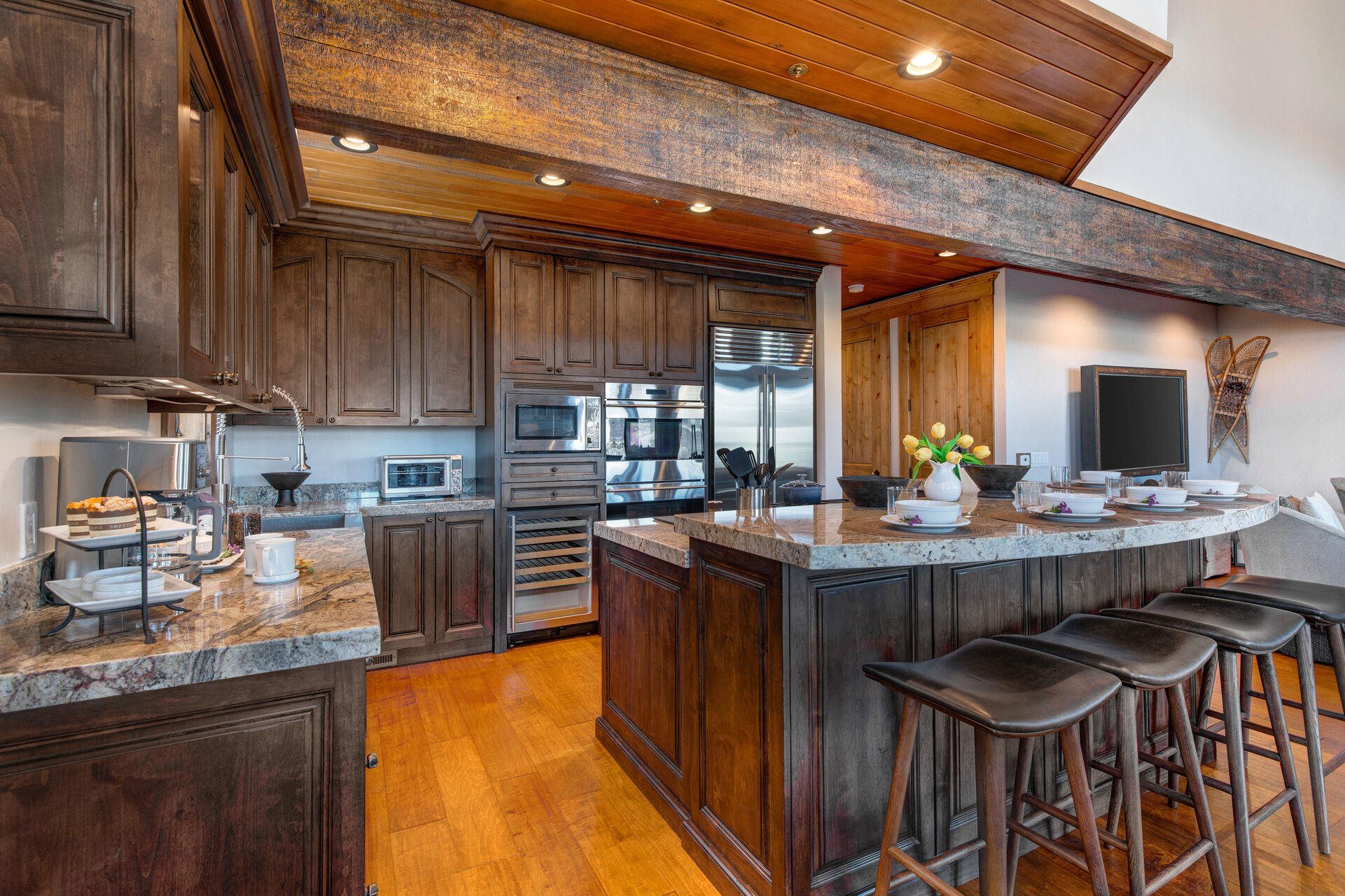 Gourmet Kitchen with Granite Counters and an Island with Seating for Six