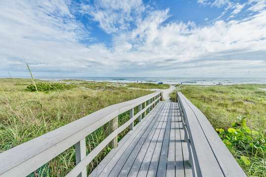 Walk right out to the beach on your private boardwalk.