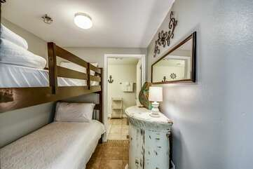 Bunk bed area adjacent to private bathroom