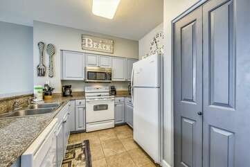 Tiled kitchen with custom built cabinets