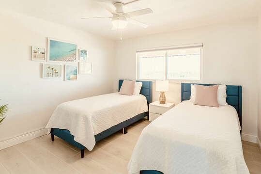 Second guest bedroom with two win beds and a big screen TV.