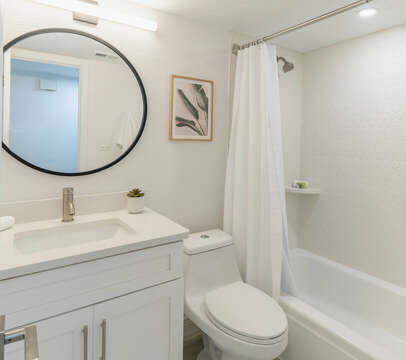 The second updated and bright bathroom.