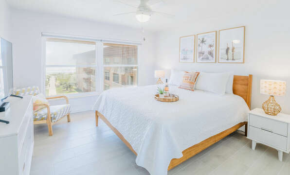 Master bedroom with ocean views, a king bed and a big screen TV.