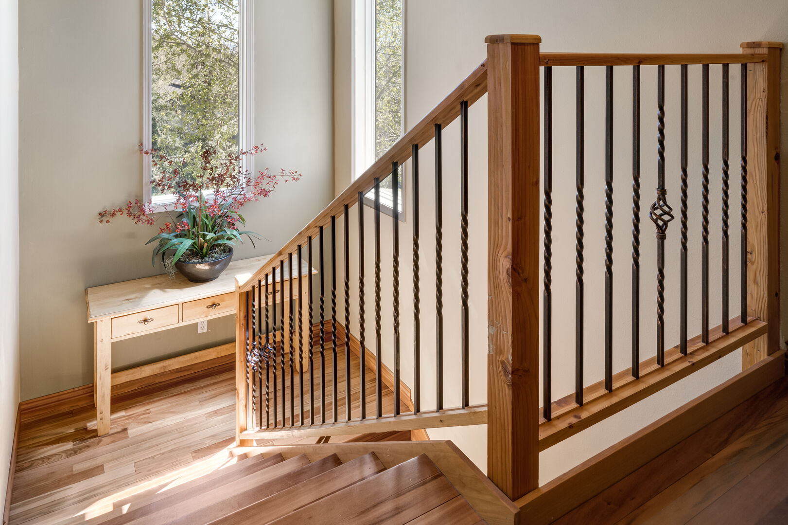 Sunny stairwell leading to the upper floor bedroom and bath, cozy nook with desk off to the right.