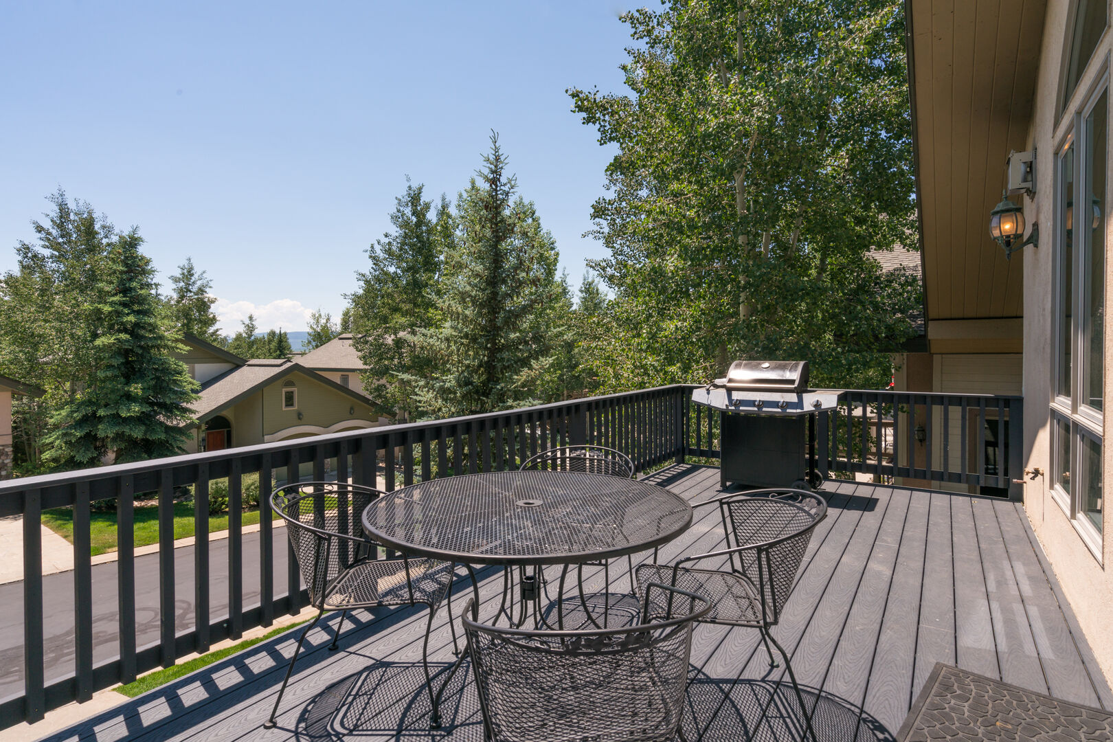 Deck off the living room with grill and dining space