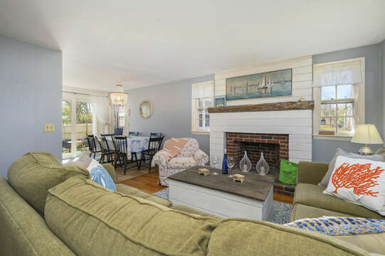 Perfect conversation area with coastal decor and driftwood fireplace - 7 Cutter Lane West Yarmouth Cape Cod - New England Vacation Rentals
