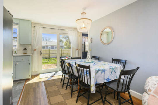 Dining room just off the kitchen with slider to the back yard - 7 Cutter Lane West Yarmouth Cape Cod - New England Vacation Rentals