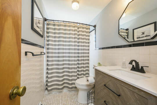 Full bathroom in hallway with tub / shower combo - 7 Cutter Lane West Yarmouth Cape Cod - New England Vacation Rentals