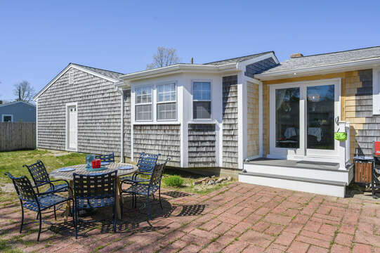Kitchen / dining room sliders lead to outdoor area - 7 Cutter Lane West Yarmouth Cape Cod - New England Vacation Rentals
