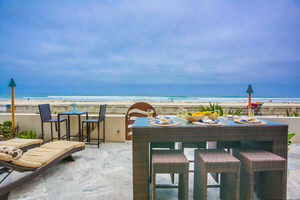 Ground Floor Oceanfront Patio w/ Fire Pit, Loungers, & Outdoor Dining
