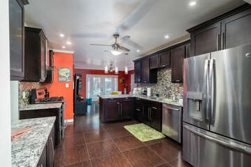 Spacious Kitchen with Plenty of Stone Counter Space