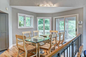 Dine in kitchen - dining table for 6, sliders out to screen porch