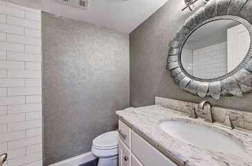 Hall bath, lower level - perfect for upstairs king or bunk room. Brand New shower, with glass door.