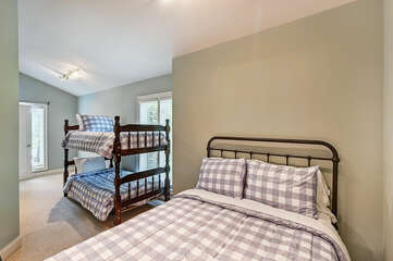 Sleeping area off master bedroom. Twin over twin bunks & full size bed.