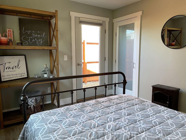Bedroom with door to outside