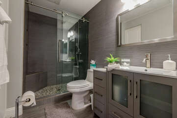 Private Bath with a Stone Counter Vanity and a Tile/Glass Shower