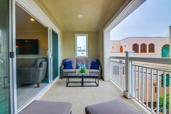 Balcony Off Living Room w/ Seating & Bay Views