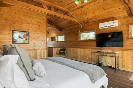 Master Bedroom with a King Bed and 60