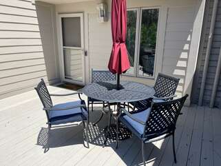 The front deck has dining for four and a propane grill