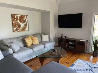 A large Smart HD TV and comfortable seating