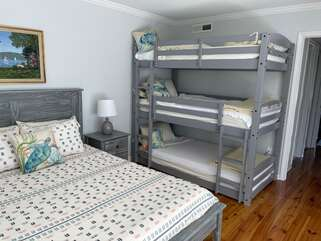 A new queen bed and unique triple bunk beds