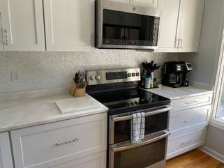 White marble countertops and Mother of Pearl backsplash tiles,