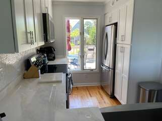 The kitchen is newly renovated with stainless steel appliances.