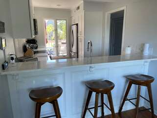 The breakfast bar stools are perfect for lunch or watching the family chef create the evening meal