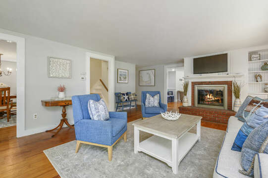 Living Room with flat screen TV, dining entry and stairs to second floor-21 Pine Street- Harwichport- Cape Cod- New England Vacation Rentals