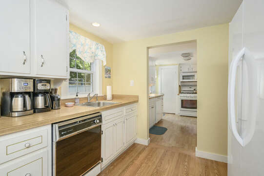 Galley kitchen with dishwasher, coffee pots,fridge-21 Pine Street- Harwichport- Cape Cod- New England Vacation Rentals