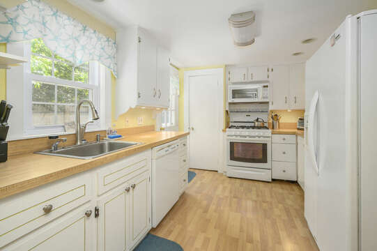 Galley style kitchen with 2nd Fridge, stove , second microwave, second dishwasher-21 Pine Street- Harwichport- Cape Cod- New England Vacation Rentals