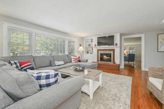 Family room with wrap around couch , flat screen tv-21 Pine Street- Harwichport- Cape Cod- New England Vacation Rentals