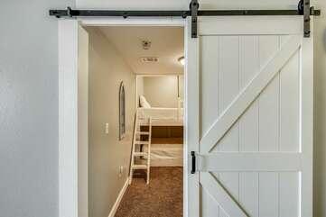 Bunk room with barn door