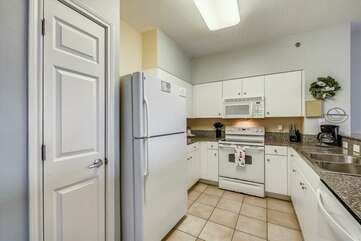 Kitchen area includes range, microwave, dishwasher, fridge/freezer, standard coffee maker, and pantry.