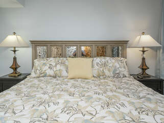 Master bedroom with king bed on first entry level