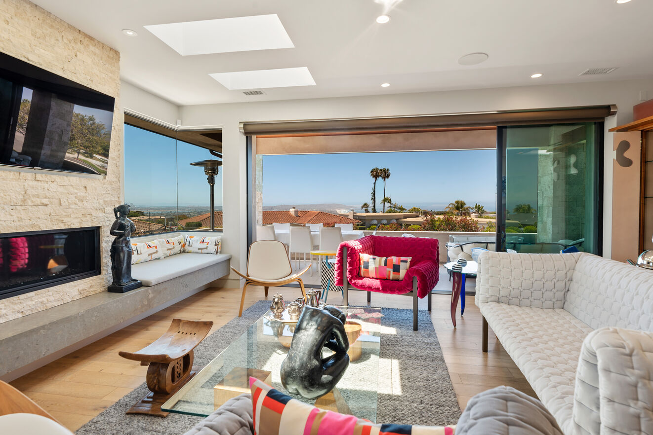 Living room and open patio with extraordinary view