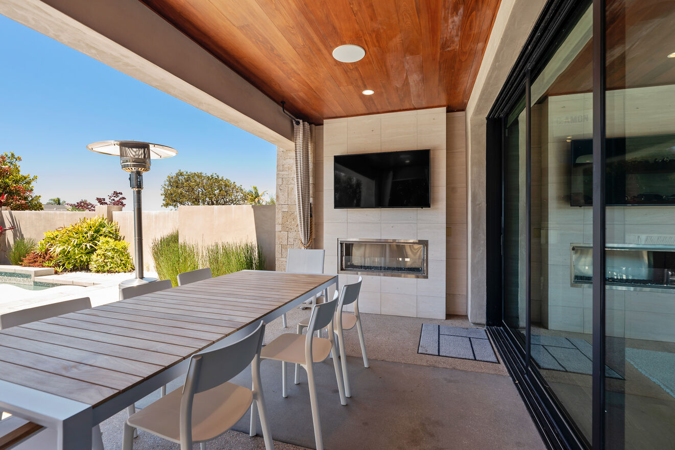 Outdoor fireplace, dining, entertainment area