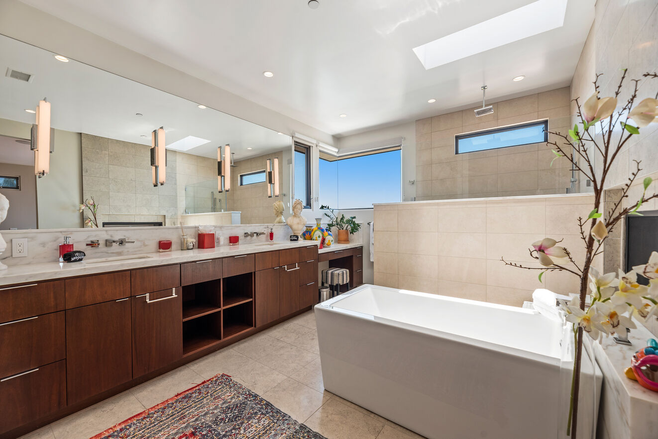 Master bathroom with large open shower and tub