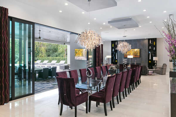 Dine at the formal dining table with seating for 20