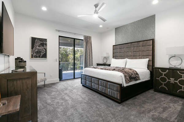 Master Suite bedroom furnished with a king-size bed, with balcony access