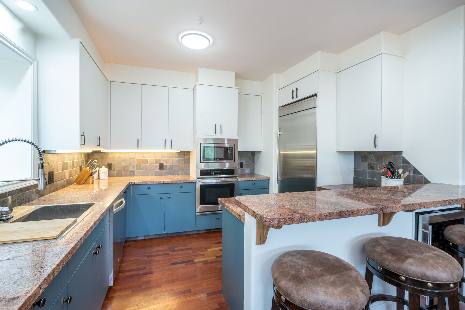 Kitchen with wood floors and stainless steel appliances