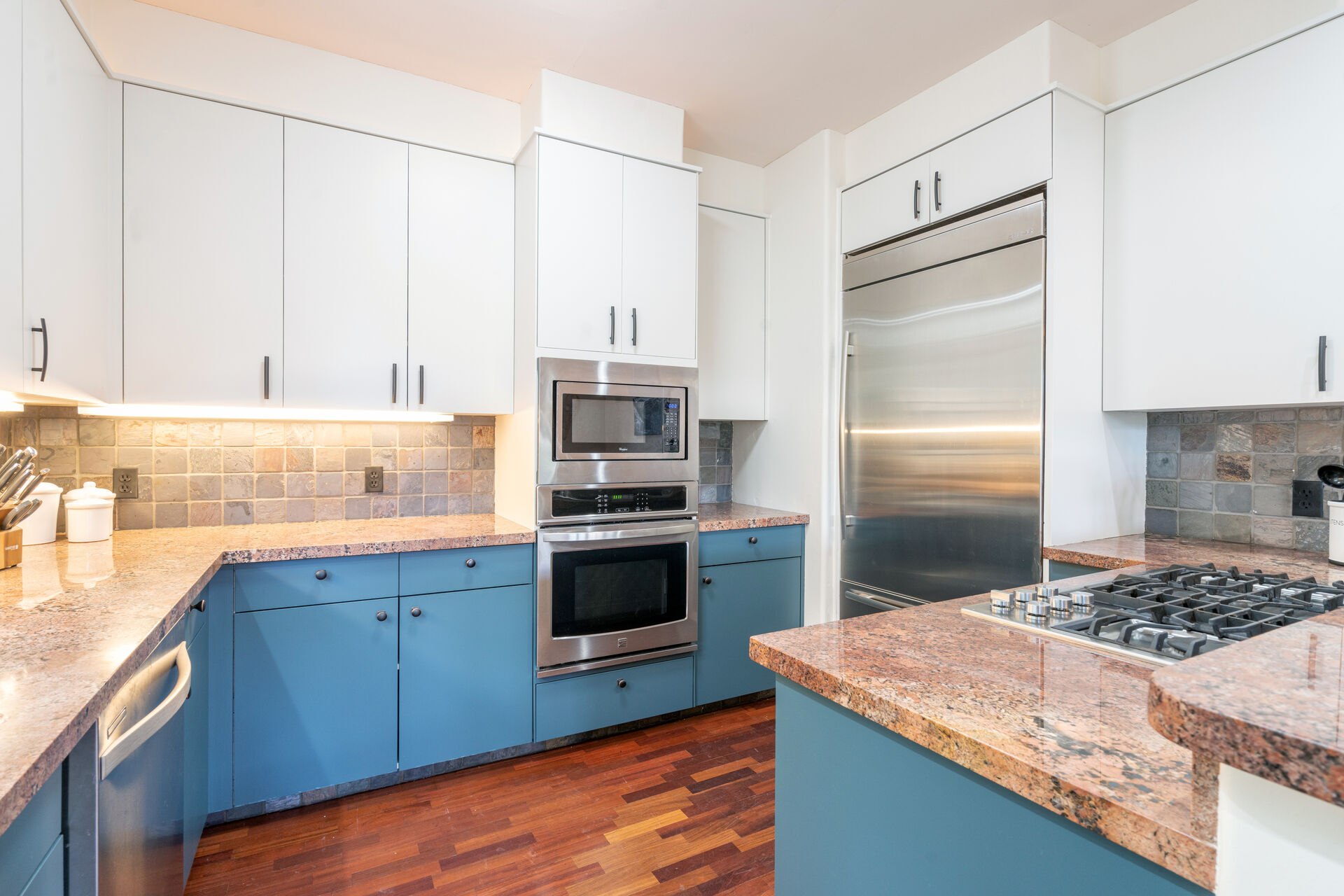 Kitchen with blue lower and white upper cabinets