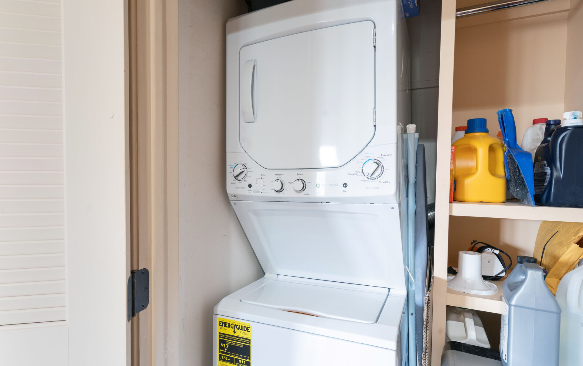 Stacked washer and dryer in cabinet